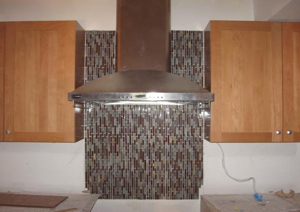Glass Tile Backsplash Is Installed In This Contemporary Kitchen.