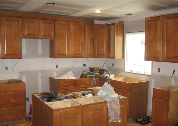 A larger more open kitchen with an island clark for Kitchen cabinets crown molding installation instructions